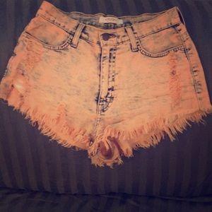 Vibrant high rise distressed shorts